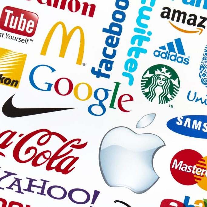 Kiev, Ukraine - February 21, 2012: A logotype collection of well-known world brand's printed on paper. Include Google, Mc'Donald's, Nike, Coca-Cola, Facebook, Apple, Yahoo, Nikon, YouTube, Adidas, Amazon.com, Unilever, Twitter, Mastercard, Samsung, Canon and Starbuck's logos.